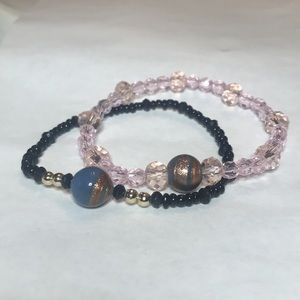Pink and black beaded bracelet made with elastic.